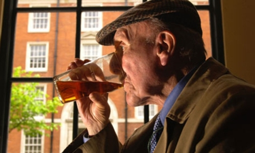 Old-man-drinking-pint-of-007